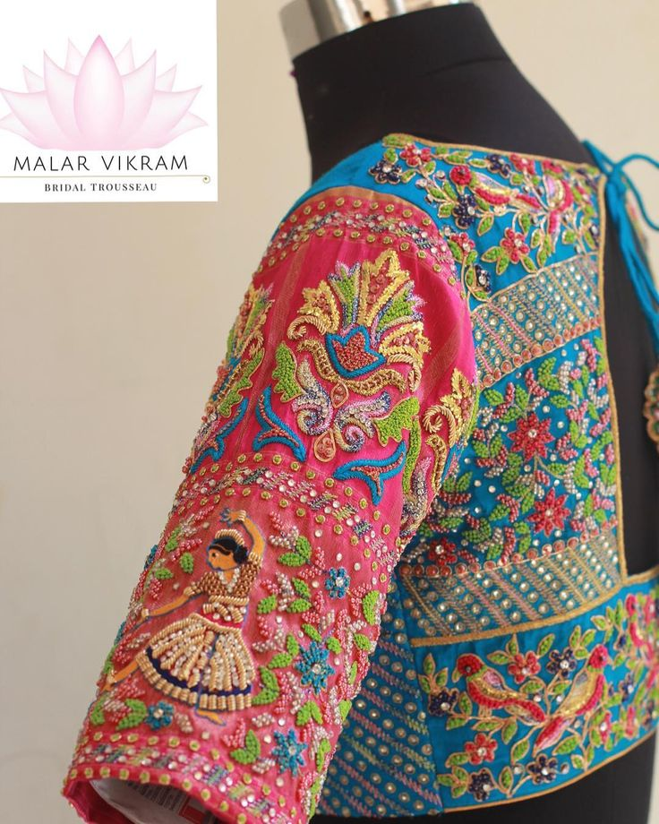 Stunning pink and powder blue color combination designer blouse with floret lata and dancing doll design hand embroidery classy thread work on sleeves. Pair of parrots design hand embroidery thread work on back of blouse.    21 March 2018
