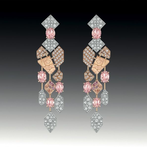 Earrings--White gold and 18K rose . 8 Padparadscha set with oval cut sapphires with a total weight of 9.2 Carats , size 4 Padparadscha sapphires Fancy, Fancy sapphires size 6 roses and 248 brilliant-cut diamonds for a total weight of 3.8 carats.