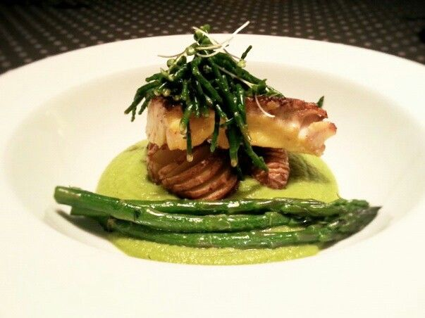 Smoked Haddock served with volute pea, asparagus, samphire and hasselback potatoes.