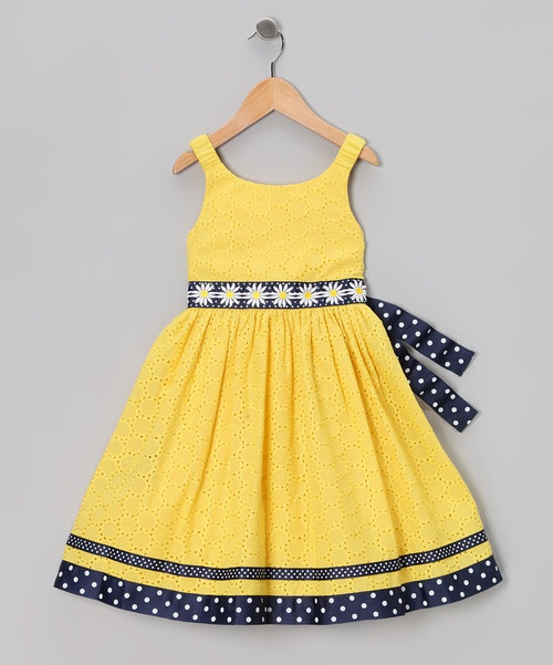 As bright as a daisy, this dress features eyelet with a contrasting tie. Stretchy straps and a zipper mean this piece is ready to join the party in playful yet pretty fashion. 66% polyester / 34% cottonLining, trim and embroidery: 100% polyesterMachine wash; tumble dryImported