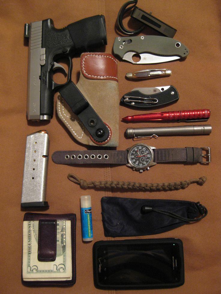 Submitted EDC By: xceptnl  Kahr CW45 (Pow' R Ball 165grn. 45+P) - DeSantis Sof-Tuck 106 V5 - Fossil Front-Pocket Wallet - Jabra Bluetooth - Manix 2 (Sprint CTS-XHP) - Schrade Old Timer (USA made circa 2004) - Spyderco Pingo - Benchmade Pen -  4Sevens Preon 2 Ti - Citizen AT0200 Eco-Drive Watch - 550 Paracord Bracelet - Benchmade Bag - Motorola Droid 4
