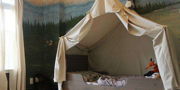 "Give your outdoorsy kid a room they will love all year round! Bring the best of ""roughing it"" indoors by building a simple camping tent bed canopy."