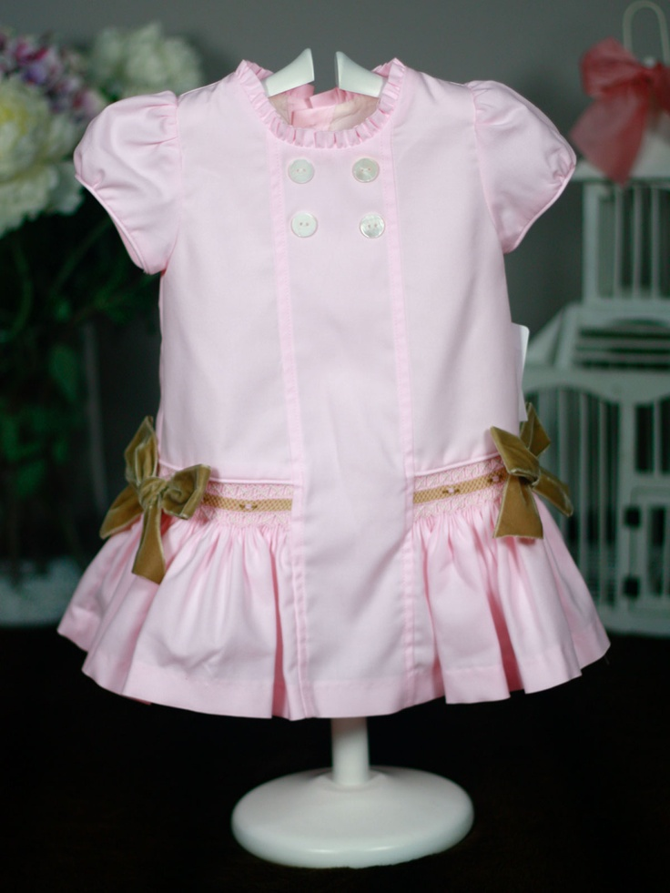 Pink girl dress with hand embroidered smock camel tones. Smocked dropped waist detail.