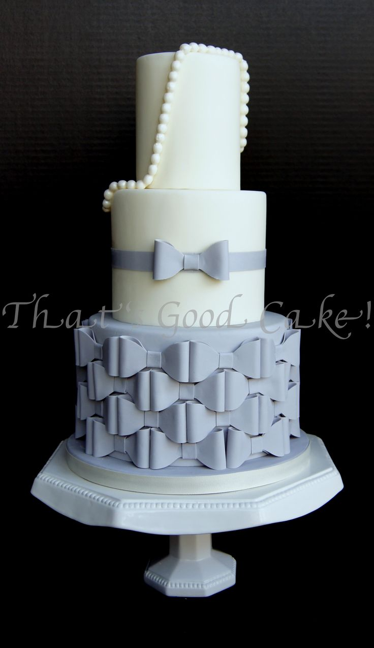 Wedding cake with dove gray bows and pearls.