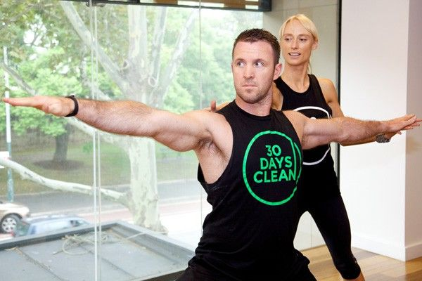 Flow Athletic's Ben Lucas with yoga instructor Kate Kendall. Image: Flow Athletica.. Learn more at frankihobson.com