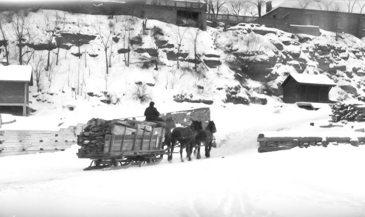 """Team with Wood, Ottawa, January, 1922."" The guy with the team of horses has just crossed the frozen Ottawa river to make his wood deliveries. I'm not quite certain where he is trying to go up the cliff, but I suspect somewhere across from Pointe Gatineau. (LAC PA-085979)"