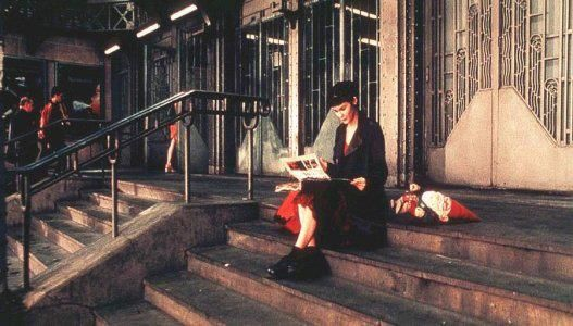 Amelie Poulain looking at Nino's scrapbook with her father's 'traveling' gnome