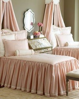 Pink bedspreads - love the seam to floor ruffle. Note desk instead of expected table between the beds.