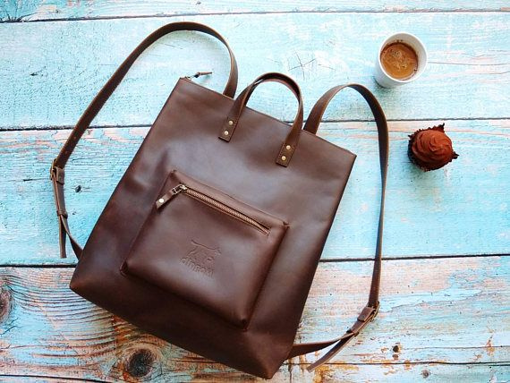 This dark brown (chocolate) leather backpack purse is our new model. It is very comfortable: you can carry this backpack on short handles in hand as a purse. This brown backpack is minimalist and stylish. We gave a name of Tokyo to this brown leather backpack. * the dimensions are: W 35 x H