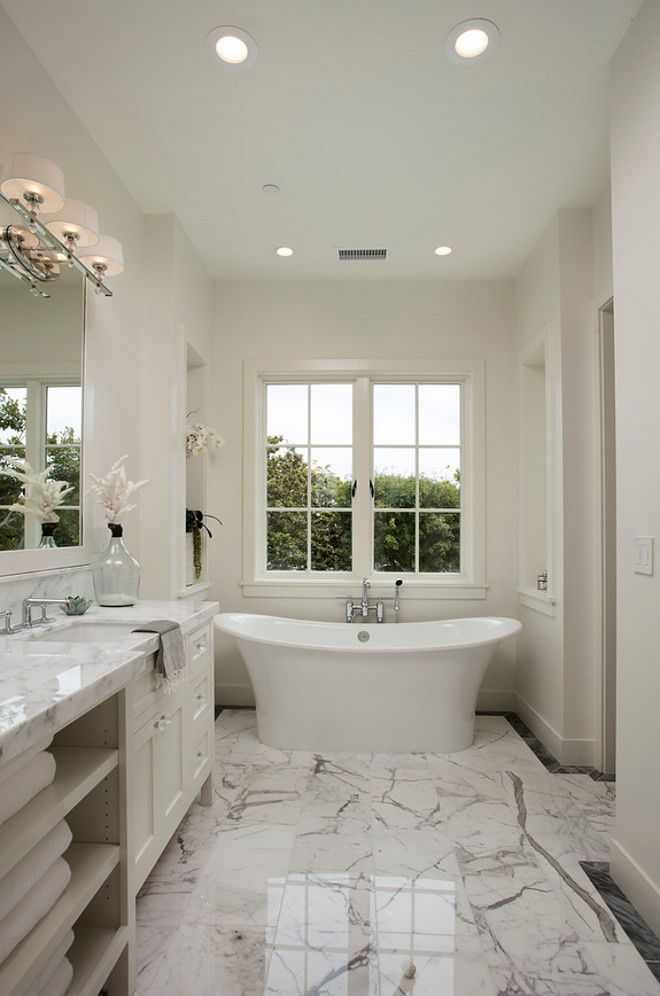 Gorgeous master bathroom with marble flooring