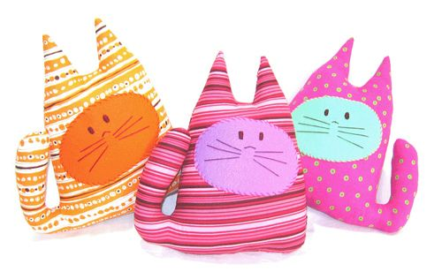 Cute fabric cats. My seven year old had a go at making her own version of these and worked out really well! Stuff with batting for soft toy or try dried pulses for beanbag effect.