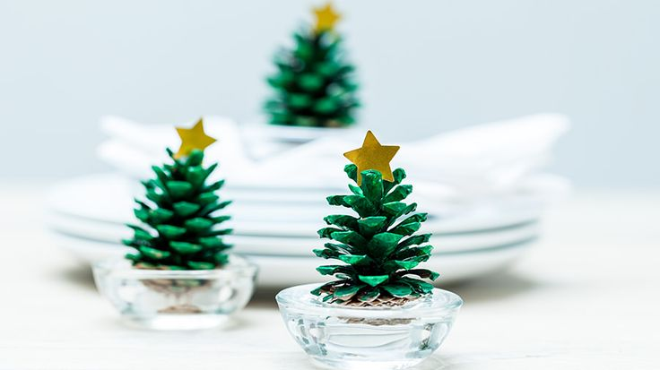 Green pine cones in candle holders | Alternative Christmas tree ideas | Tesco Living