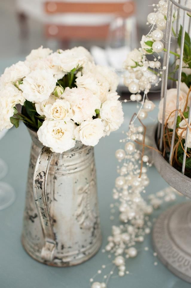 White roses in a rustic jar. Decor ideas. - http://www.hillcrestfarm.co.za/venues/weddings