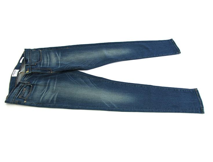 Jeans      Lay jeans flat in front of you.     Fold left leg over the right.     Fold in the crotch.     Fold over the bottom toward the waist leaving an inch of space.     Fold inward until jeans stand upright.