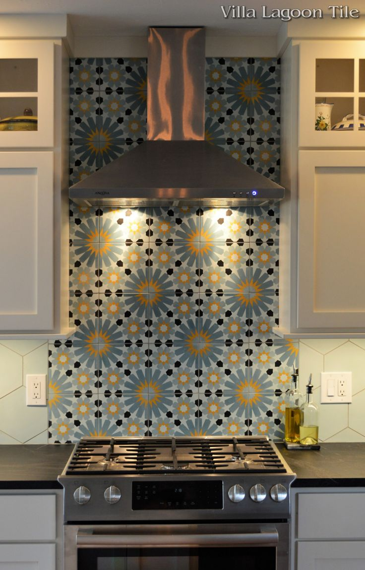 "Our square ""Tangier"" and ""Atmosphere"" Hex handmade cement tile blend beautifully in this backsplash."