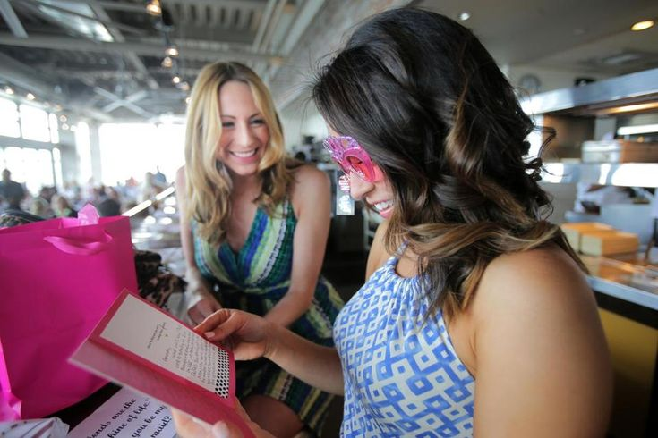 Danielle Vollmar (far left) with Amanda Guerra at Legal Harborside, where Vollmar asked Guerra to be in her wedding.