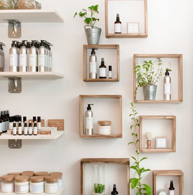 Mirins Copenhagen framed wall of products with stevia, mint and geranium plants