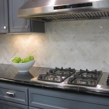 kitchen calcutta gold backsplash  Hampton Carrara marble backsplash herringbone pattern detail