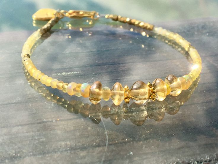 A personal favourite from my Etsy shop https://www.etsy.com/no-en/listing/559488071/citrine-bracelet-with-welo-fire-opals