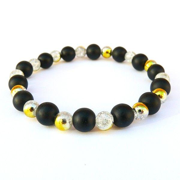 Náramek je vyrobený z černých matných skleněných korálků doplněný o práskané korálky s krásnými zlatým efektem. Korálky jsou navlečené na lycru, která je elastická a usnadňuje navlečení i svlečení z ruky.