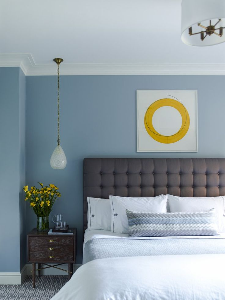 Soothing blue bedroom design by Mendelson Group