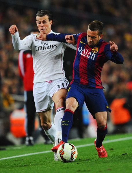 Gareth Bale of Real Madrid CF battles with Jordi Alba of Barcelona during the La Liga match between FC Barcelona and Real Madrid CF at Camp Nou on March 22, 2015 in Barcelona, Spain.