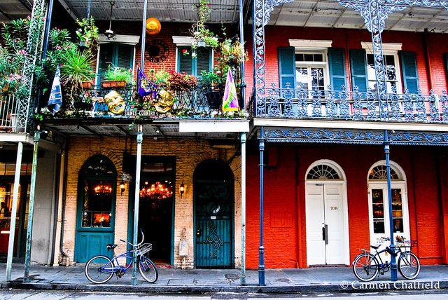Bikes Parked Outside Colorful Buildings In New Orleans