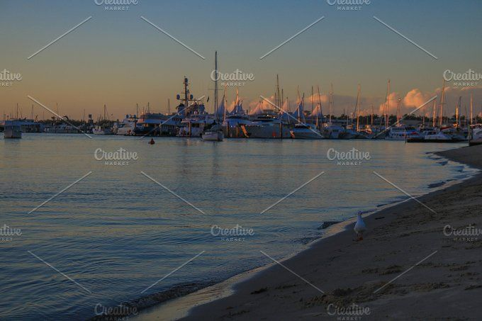 Sunset with boats by NotJustVisual on @creativemarket