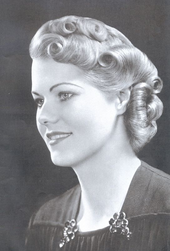 1930 ~~ I wonder; is this hairstyle done with long hair, curled and pinned?