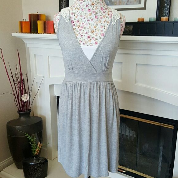 Grey Summer Dress Very stylish Summer dress. Great material 95% Rayon 5% Spandex. So has a great feel to it. No stains or snags. Previously loved! Dresses