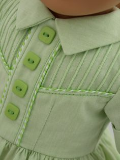 SHELBY SHIRTWAIST IN LIME: Inspired by vintg Swiss pattern, feat corded pintucks & piping trim. Fitted shirtdress has front yoke, faux front placket, square bias-cut collar, short sleeves with turned up cuffs, and full dirndl-style skirt. Made from cotton chambray, cross-woven with lime and white thread for lime-sherbet effect. Coordinating whip-stitch piping is perfect color match. Bodice lined w/Imperial batiste. Back placket closes w/buttonholes & mother-of-pearl buttons. | Kindred…
