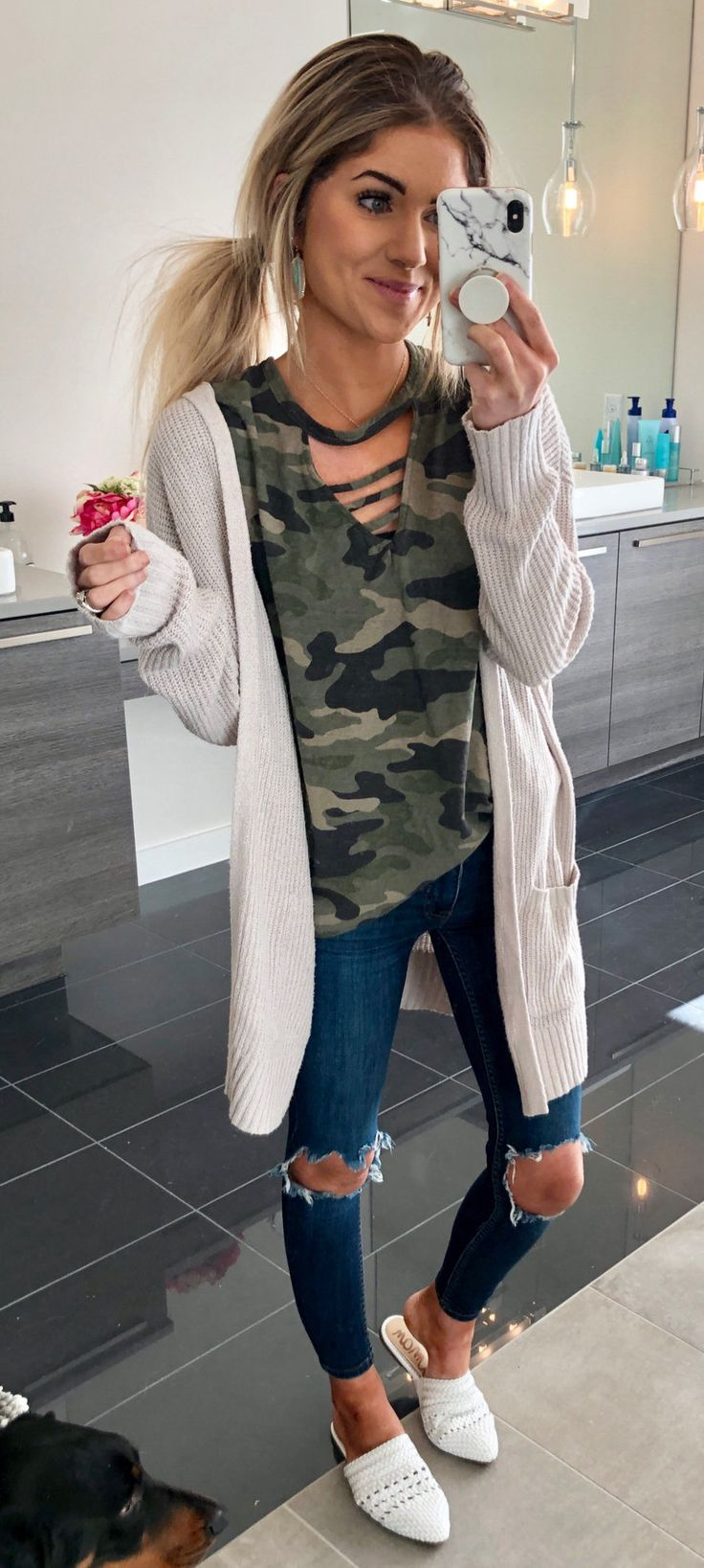 green and black camouflage t-shirt, white long-sleeved cardigan, and distressed blue denim fitted jeans #spring #outfits