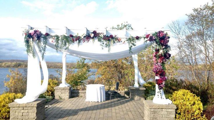 #cldesigns #cldesignteam #reneejuliephotography #floralswag #archway #weddingarchway #marsala #purple #greenery #red #jeweltonewedding