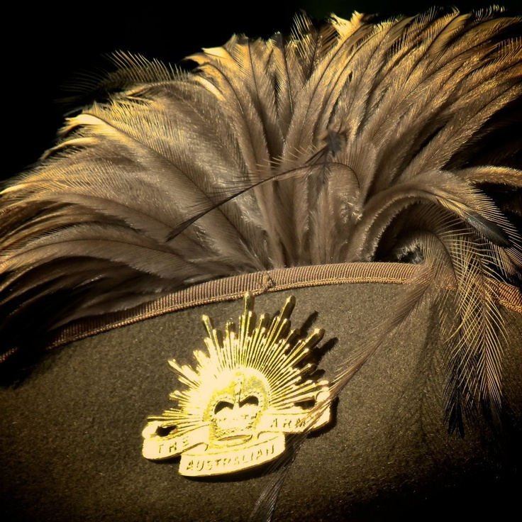 Slouch hats worn by members of the Armoured Corps are adorned with Emu plumes, a tradition that originated with the Queensland Mounted Infantry during the great shearers' strike in Queensland in 1891. During this time, the Queensland Mounted Infantry were called out, as soldiers to aid the Civil Power.