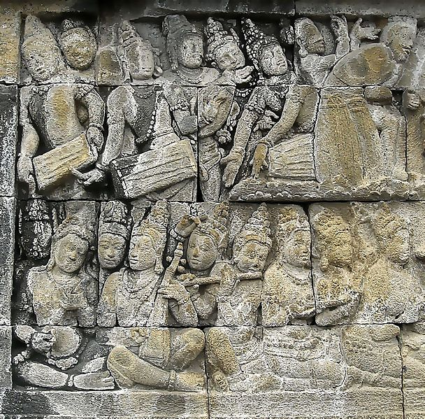 Bas-relief depicting palace musicians performing musical ensemble, probably the ancient form of Javanese gamelan on the 8th century Borobudur temple, Central Java, Indonesia.