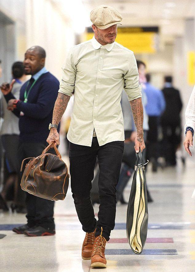 Stylish David Beckham lands at JFK Airport in NYC (http://creativegentleman.com/david-beckham-rocks-rrl-shirt-red-wing-boots-and-saint-laurent-jeans-at-jfk-airport/ #davidbeckham #ralphlauren #rrl #saintlaurent #jeans #redwing #boots