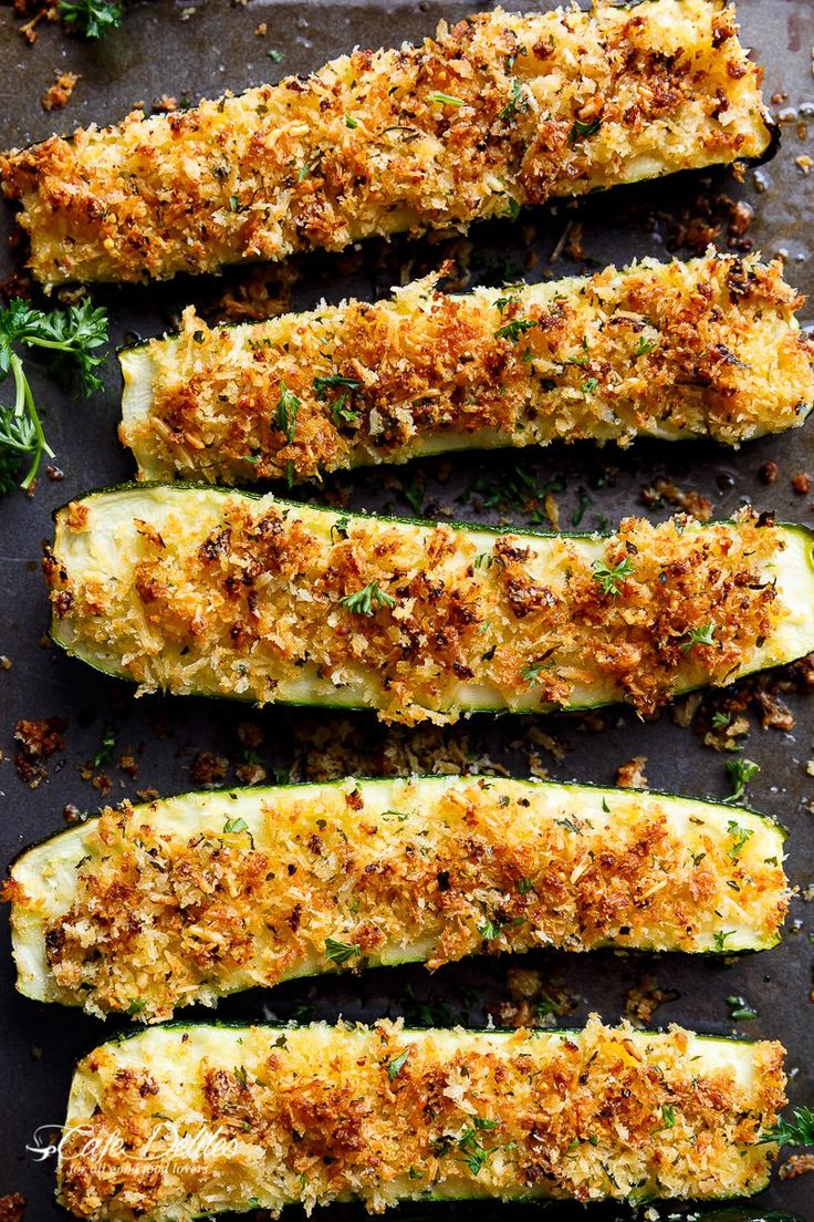 Parmesan Crusted Zucchini are easy to make and are one of THE best ways to enjoy zucchini! Crispy and crunchy, the perfect side dish OR snack!