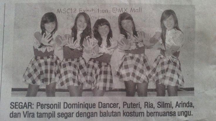 DOMINIQUE Dancer in newspaper