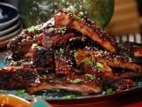Japanese Grillin: Bobby Flay's Barbecue Addiction | Food Network:  Chicken Yakitori; Seared Tuna, Yellowtail and Salmon with Three Dipping Sauces;  Asian Spice Rubbed Ribs with Pineapple-Ginger BBQ Sauce and Black and White Sesame Seeds; and Miso Glazed Grilled Japanese Eggplant.
