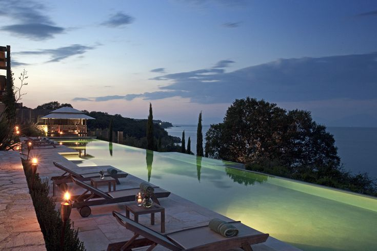 Kingfisher Point, Avlaki and Coyevinas - Sleeps up to 14. A scenic headland is the setting for this luxury villa in Corfu. The accommodation is spacious and chic, the service is superb, and the views from the exceptional swimming pools are spectacular.