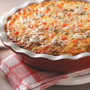 Monterey Sausage Pie | Taste of Home    •1 pound bulk pork sausage  •1 cup chopped onion  •1 cup chopped sweet red pepper  •1/2 cup chopped fresh mushrooms  •3 teaspoons minced garlic  •2-1/2 cups (10 ounces) shredded Monterey Jack cheese, divided  •1-1/3 cups milk  •3 eggs  •3/4 cup biscuit/baking mix  •3/4 teaspoon rubbed sage  •1/4 teaspoon pepper