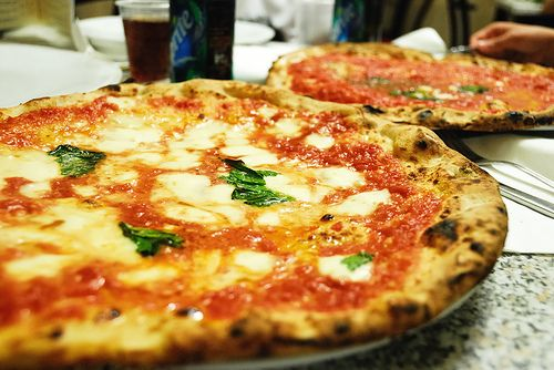 Italian pizza...Just thin, smoky crust, fresh tomato sauce, fresh mozzarella, and fresh basil.  The absolute best!