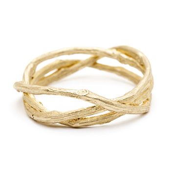 """Three is the magic number..."" Three sinuous twig branches are woven in an asymmetric pattern, symbolizing unity and strength. Available in women's and men's sizes, this ring makes a unique, non-traditional wedding band. LOVE. LOVE. LOVE. 14K Yellow Gold. $850"