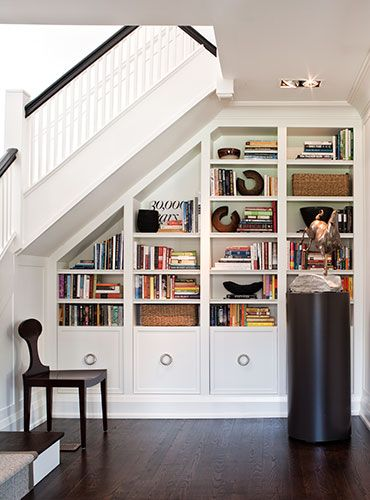 Powell and Bonnel Design Inc. Clever and attractive way of using a formerly dead space. Nice arrangement and styling of bookcase.