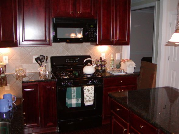 Cherry kitchen cabinets with black granite love my for Cherry kitchen cabinets with black granite