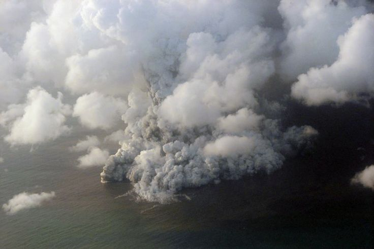 An undersea volcano erupts off the coast of Tonga, tossing clouds of smoke, steam and ash thousands of feet (meters) into the sky above the South Pacific ocean, in 2009.