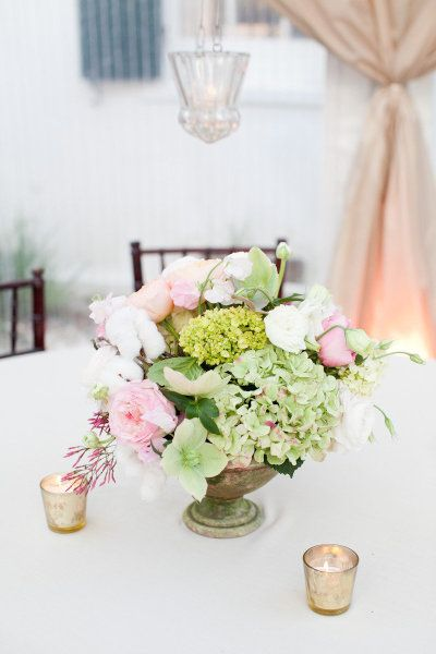 pale green and pink centerpieces held in vintage urns | Photography by gaylebrooker.com |  Event Design + Coordination by southernprotocol.com |  Floral Design by charlestonstems.com |   Read more - http://www.stylemepretty.com/2013/07/08/charleston-wedding-from-gayle-brooker/