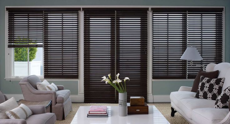 Dark wood blinds complement existing decor in this traditional living room.