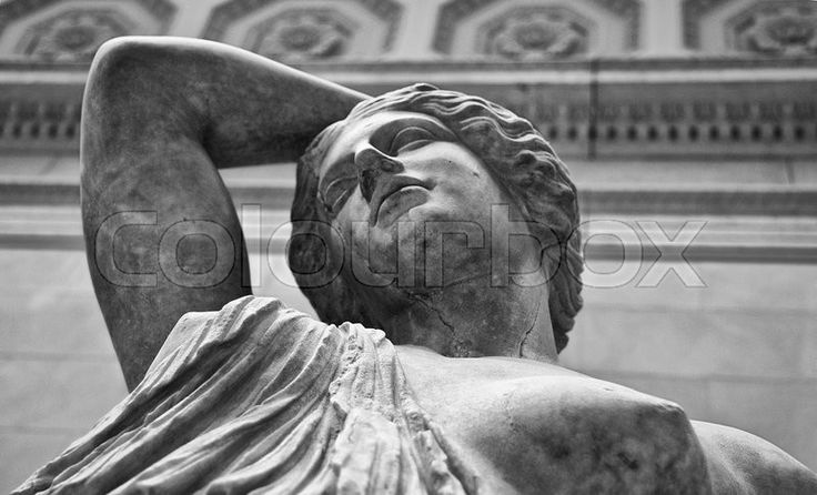 Stock image of 'Marble statue of a wounded Amazon. Black and white shot'