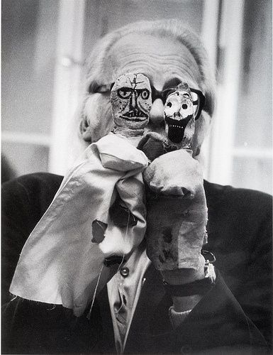 Paul Klee holding puppets of his own design